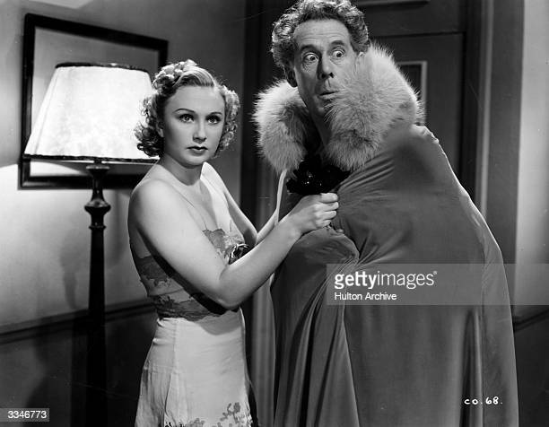 British actors Googie Withers and Wilfred Walter star in the Gainsborough comedy 'Convict 99' directed by Marcel Varnel