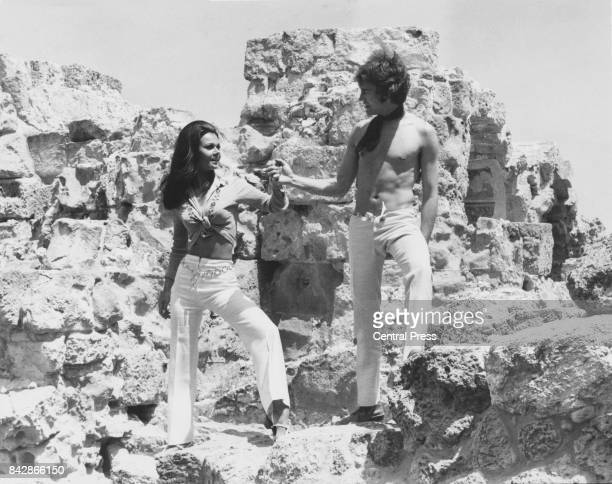 British actors Imogen Hassall and Patrick Mower pose amongst the ruins of ancient Salamis on Cyprus during the making of the British horror film...