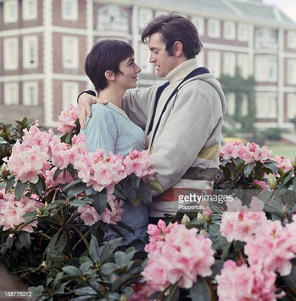 British actors Jacqueline Pearce and Patrick Mower amid rhododendrons 1968