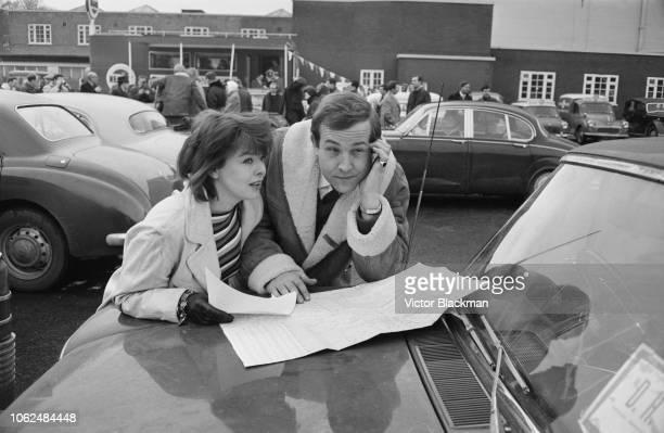 British actors Janet Munro and Ian Hendry at a showbiz car rally UK 4th February 1963