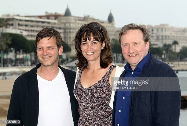 """British actors Jason Hughes, Fiona Dolman and Neil Dudgeon, pose during a photocall for their serie """"Midsomer Murders, Inspector Barnaby"""", during the..."""