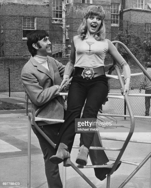 British actors John Alderton and Carol Hawkins as they appear in the British comedy film 'Please Sir' directed by Mark Stuart 5th May 1971 The film...