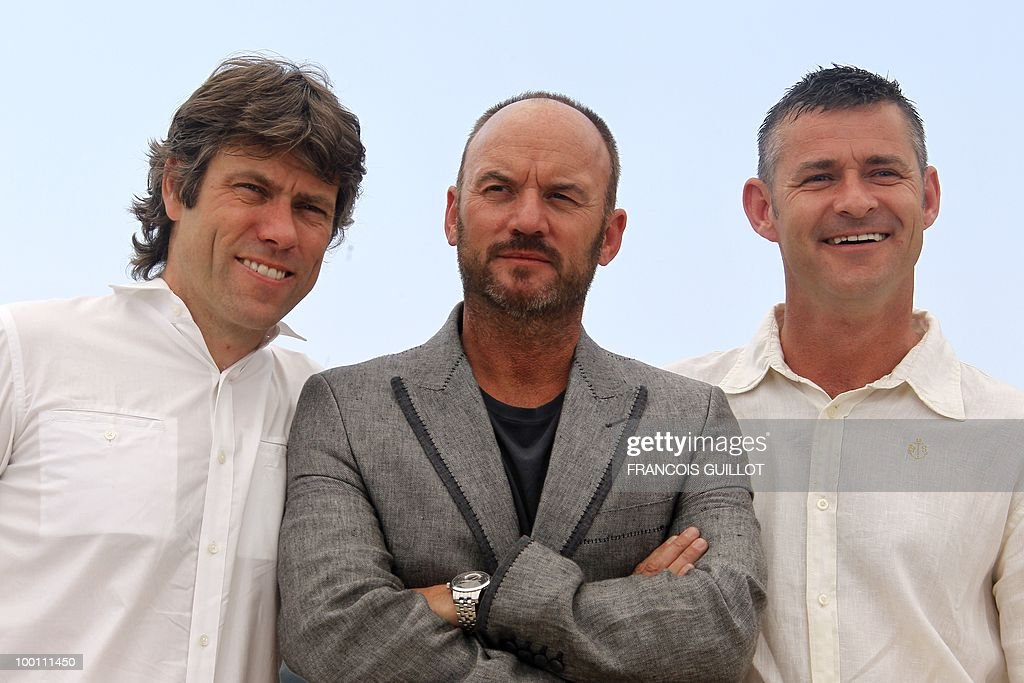 British actors John Bishop (L), Mark Womack (C) and Trevor Williams pose during the photocall 'Route Irish' presented in competition at the 63rd Cannes Film Festival on May 21, 2010 in Cannes.