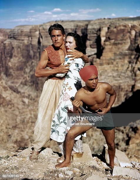 British actors John Justin, June Duprez and Indian actor Sabu on the set of The Thief of Bagdad.