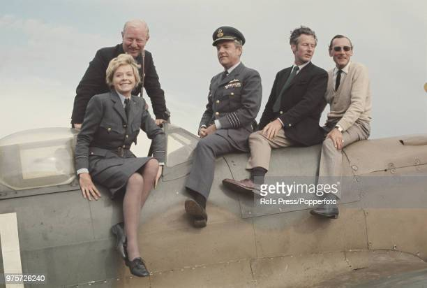 British actors Kenneth More and Susannah York pictured in uniform together with former RAF officers James Harry 'Ginger' Lacey Peter Townsend and...