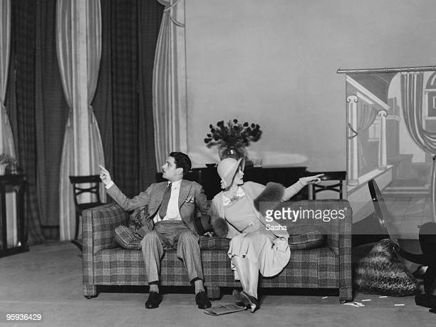 British actors Laurence Olivier and Adrianne Allen in a production of Noel Coward's play 'Private Lives' at the Phoenix Theatre London 12th September...