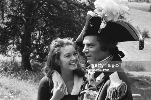 British actors Laurence Olivier and Janette Scott on the set of Guy Hamilton's historical drama 'The Devil's Disciple' Tring Park Hertfordshire 31st...
