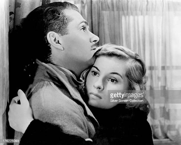 British actors Laurence Olivier as Maxim de Winter and Joan Fontaine as The Second Mrs de Winter in 'Rebecca' directed by Alfred Hitchcock 1940