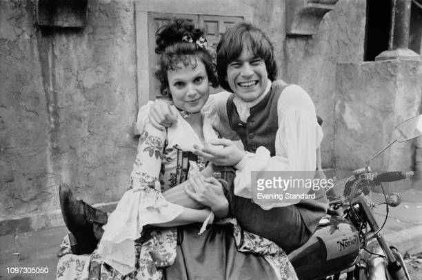 British actors Madeline Smith as 'Sophia' and Nicky Hanson as 'Tom Jones' on a motorcycle on the set of British comedy film 'The Bawdy Adventures of...