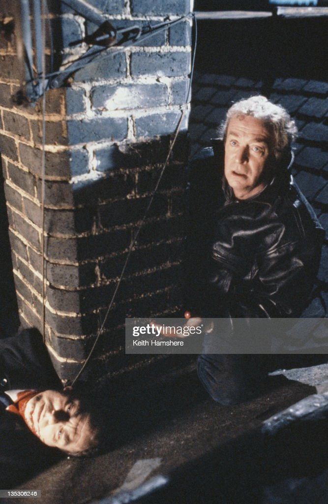 British actors Michael Caine as former secret agent Harry Anders and Alun Armstrong (left) as his police contact Osgood in the film 'Blue Ice', 1992.