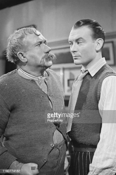 British actors Morland Graham on left and John Mills pictured together in character as Old Bill and Bill Busby during the shooting of a scene from...