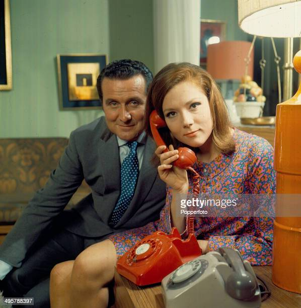 British actors Patrick Macnee and Diana Rigg posed together on the set of the television series 'The Avengers' in 1968.