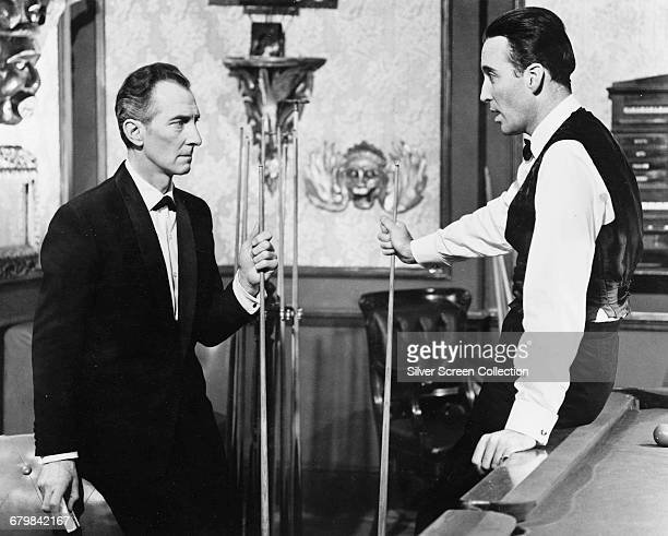 British actors Peter Cushing as Dr Christopher Maitland and Christopher Lee as Sir Matthew Phillips in the British horror film 'The Skull' 1965