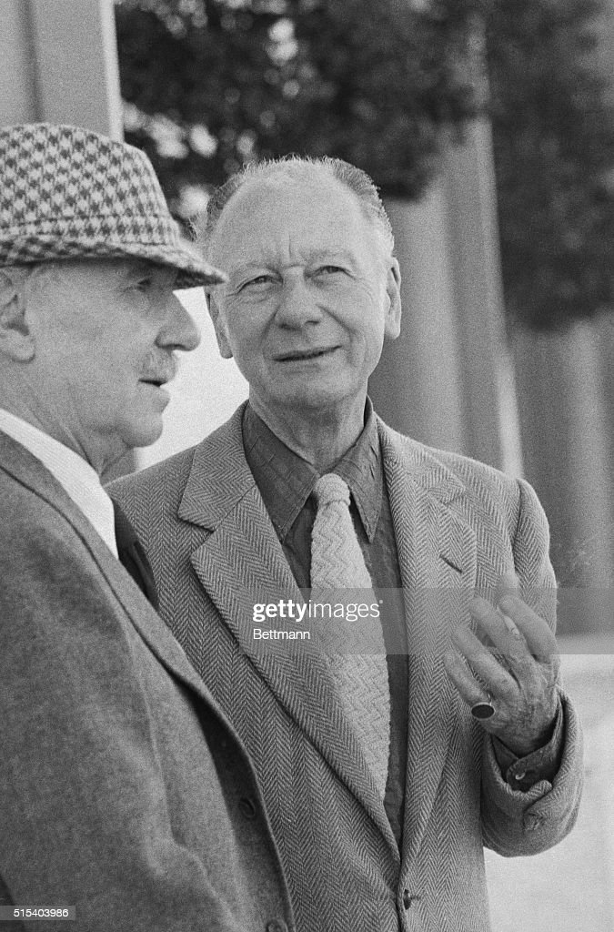 British actors Ralph Richardson (left) and John Gielgud, who have been knighted in recognition of their work, relax outside the John F. Kennedy Center. The two were taking a break during appearances in No Man's Land, a new play by Harold Pinter. Richardson and Gielgud first met and began working together in 1930. They have collaborated in fifteen theatrical productions and two movies.