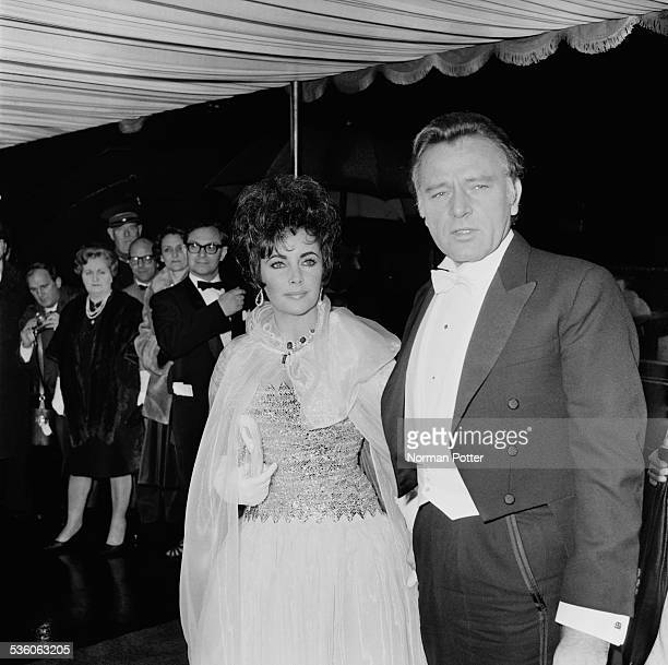 British actors Richard Burton and Elizabeth Taylor arrive at the Odeon cinema for a Royal Film Performance 27th February 1967