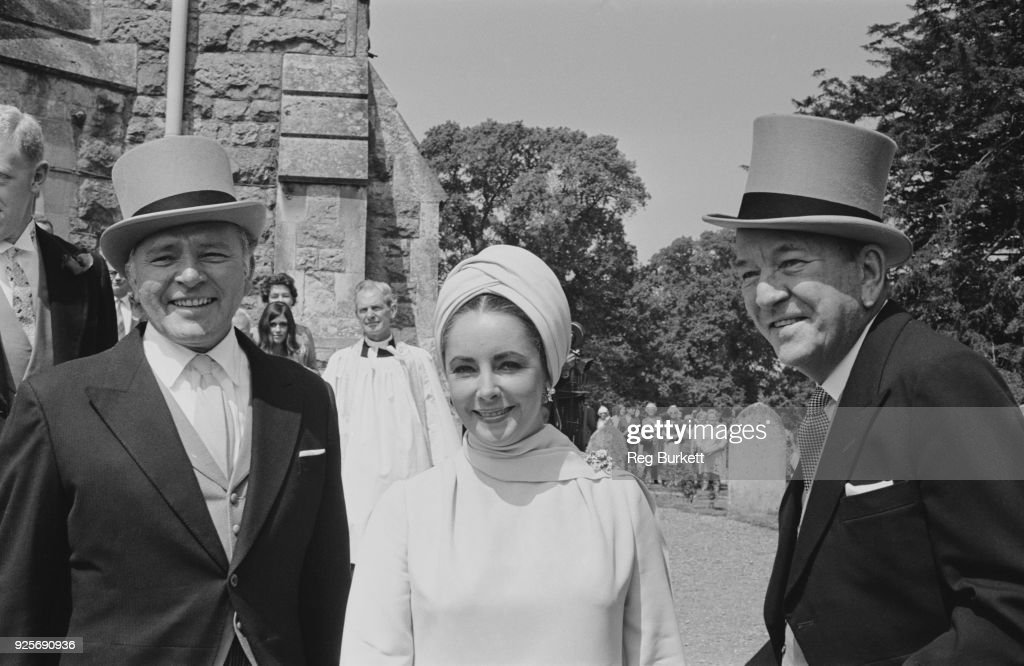 British actors Richard Burton (1925 - 1984), Elizabeth Taylor (1932 - 2011) and Noel Coward (1899 - 1973) attend the wedding of Sheran Cazalet and Simon Horby, UK, 15th June 1968.