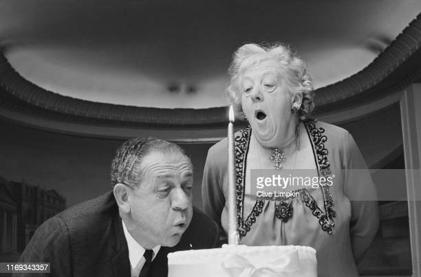 British actors Sid James and Margaret Rutherford share birthday cake at the Saville Theatre London UK 12th May 1965