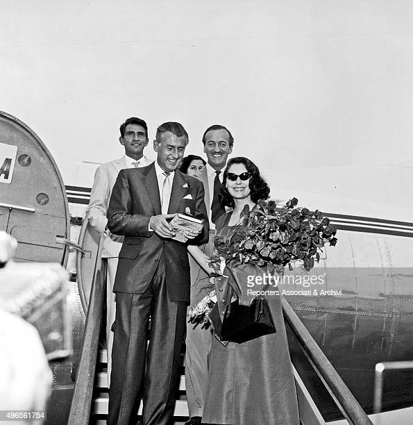 British actors Stewart Granger and David Niven with American actress Ava Gardner just landed at Ciampino Airport walking down the ladder They'll work...