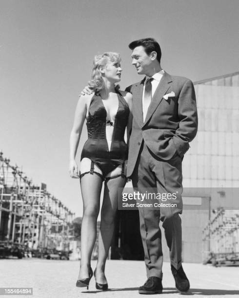 British actors Sylvia Syms, as Maisie King, and Laurence Harvey as Johnny Jackson in 'Expresso Bongo', directed by Val Guest, 1960.