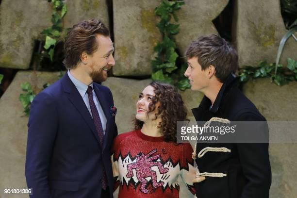 British actors Tom Hiddleston Maisie Williams and Eddie Redmayne pose on the carpet arriving to attend the world premiere of the film Early Man in...