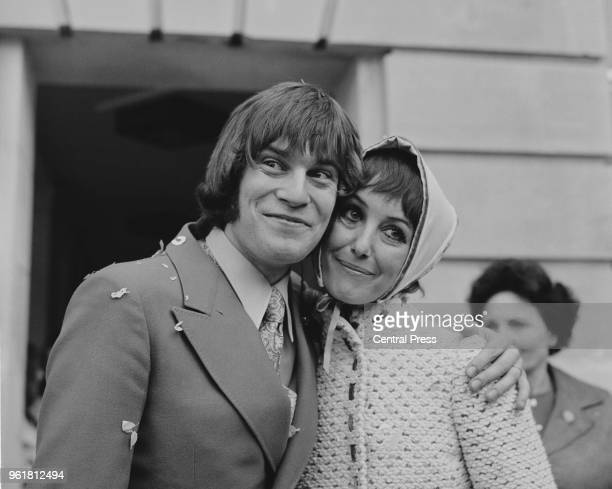 British actors Una Stubbs and Nicky Henson after their wedding at Wandsworth Register Office in London 10th October 1969 Stubbs is wearing a knitted...