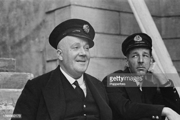 British actors Wally Patch , on left, and Ronald Shiner , dressed in character as Sutton and Ernie, on set during production of the film 'The Seventh...