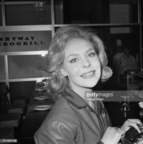 British actress actress Janine Gray at London Airport before a flight to the USA 30th October 1963