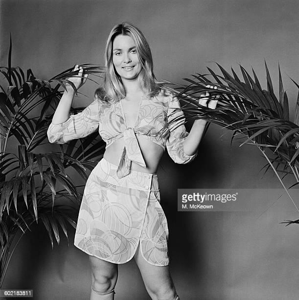 British actress Alexandra Bastedo models a dripdry cotton shirt and matching wrap skirt UK 7th January 1971