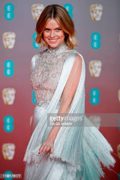 British actress Alice Eve poses on the red carpet upon arrival at the BAFTA British Academy Film Awards at the Royal Albert Hall in London on...