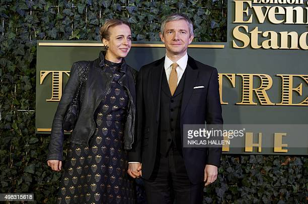 British actress Amanda Abbington and British actor Martin Freeman pose on the red carpet as they arrive to attend the 61st London Evening Standard...