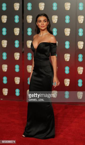 British actress Amy Jackson poses on the red carpet upon arrival at the BAFTA British Academy Film Awards at the Royal Albert Hall in London on...