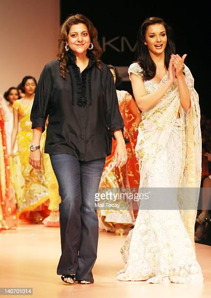 British actress Amy Jackson walks the ramp with desginer Bhairvi Jaikishan at the Lakme Fashion Week in Mumbai on Friday