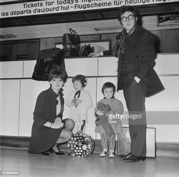 British actress and author Joan Collins with husband actor and singersongwriter Anthony Newley and their two children Tara and Sacha at Heathrow...
