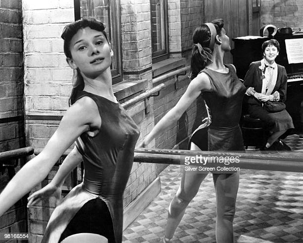 British actress and dancer Audrey Hepburn rehearsing at the barre circa 1950