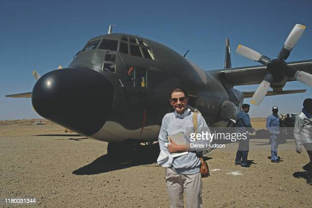 British actress and humanitarian Audrey Hepburn near an aircraft on her first field mission for UNICEF in Ethiopia, 16th-17th March 1988.