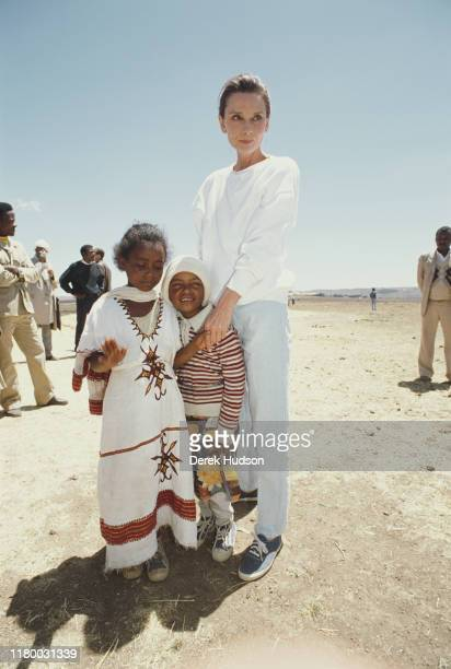 British actress and humanitarian Audrey Hepburn with local children on her first field mission for UNICEF in Ethiopia 16th17th March 1988