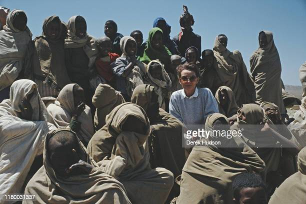 British actress and humanitarian Audrey Hepburn with local women on her first field mission for UNICEF in Ethiopia, 16th-17th March 1988.