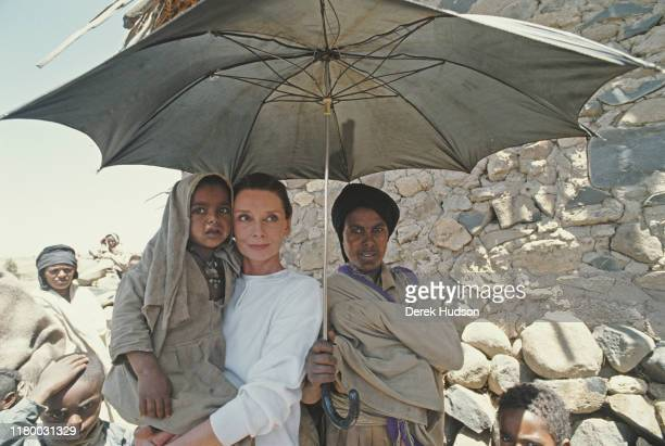 British actress and humanitarian Audrey Hepburn with locals on her first field mission for UNICEF in Ethiopia 16th17th March 1988