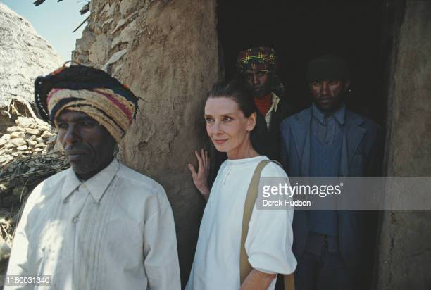 British actress and humanitarian Audrey Hepburn with locals on her first field mission for UNICEF in Ethiopia, 16th-17th March 1988.