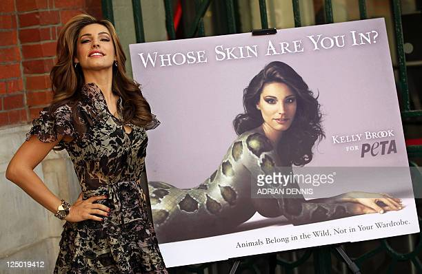British actress and model Kelly Brook poses beside a poster as she unveils a campaign for People for the Ethical Treatment of Animals in London on...