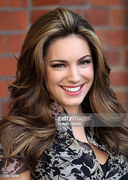 British actress and model Kelly Brook poses for photographs as she unveils a campaign for People for the Ethical Treatment of Animals in London on...