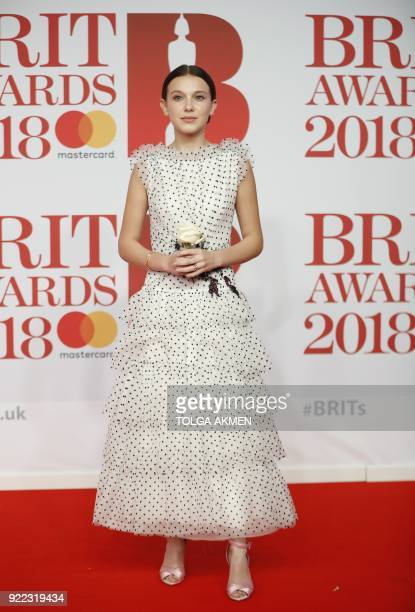 British actress and model Millie Bobby Brown poses on the red carpet on arrival for the BRIT Awards 2018 in London on February 21 2018 / AFP PHOTO /...
