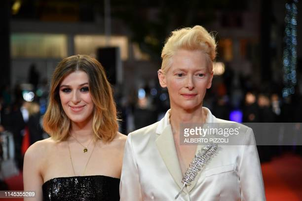 """British actress and model Tilda Swinton and her daughter Honor leave the Festival Palace after the screening of the film """"Once Upon a Time... In..."""