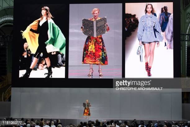 """British actress and model Tilda Swinton performs on stage during the """"Karl For Ever"""" event to honour late German fashion designer Karl Lagerfeld at..."""