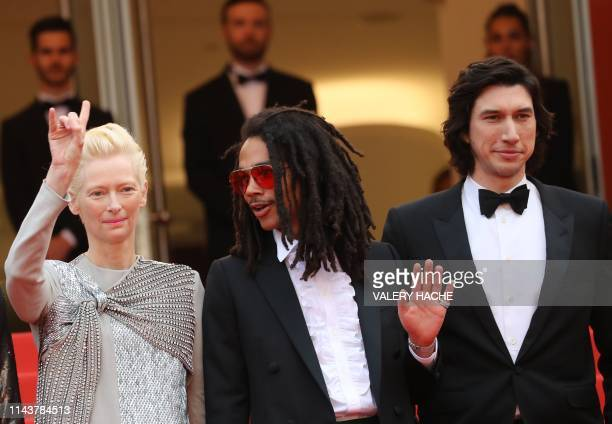 British actress and model Tilda Swinton US actor Luka Sabbat and US actor Adam Driver pose as they arrive for the screening of the film The Dead...