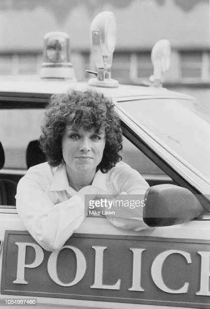 British actress and novelist Jill Gascoine sitting in the front seat of a police car UK 27th November 1979