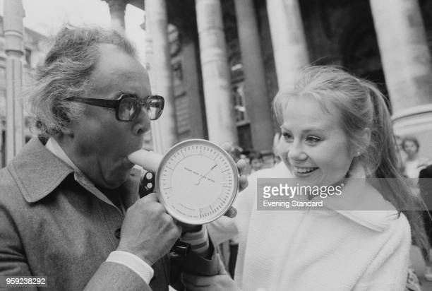 British actress and performer Shirley Cheriton helping British actor and activist Brian Rix to breath into a peak flow meters London UK 23rd June 1978