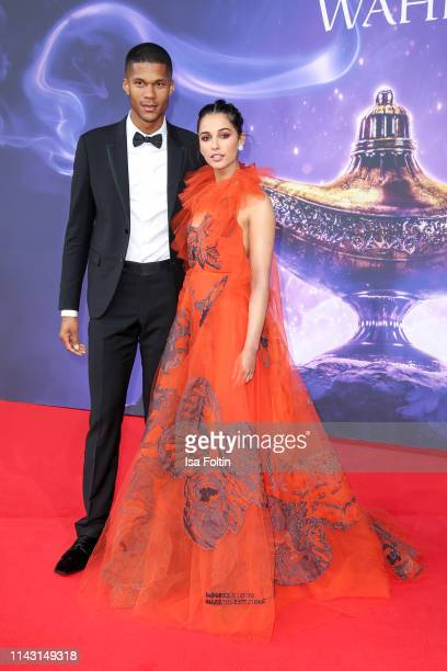 British actress and singer Naomi Scott and her husband Jordan Spence attend the movie premiere of Aladdin at UCI Luxe Mercedes Platz on May 11 2019...