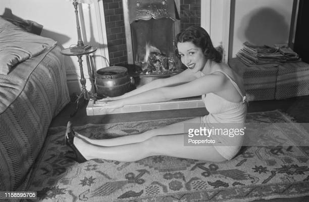 British actress and singer Pat Kirkwood pictured doing her physical exercises prior to appearing in a performance of Black Velvet at the Hippodrome...