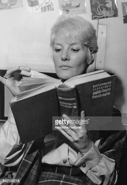 British actress and singer Petula Clark reads a French-English dictionary in Paris, France, November 1960.